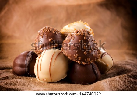 Sweet and tasty Belgium white and dark chocolate pralines - stock photo