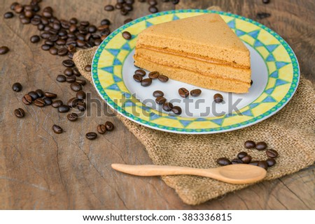Sweet and tasty Coffee flavoured cake in dish and wooden spoon.  great for during coffee break - top view - stock photo