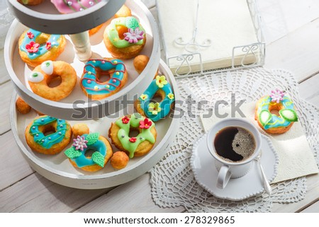 Sweet and tasty donuts served with coffee - stock photo