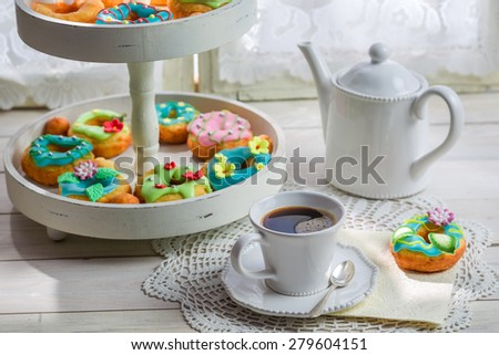 Sweet and tasty donuts with colorful decoration - stock photo