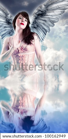 Sweet angel, over cloud background in the water. Woman with wings - stock photo