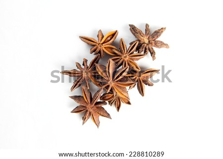 Sweet anise star seeds on white background - stock photo