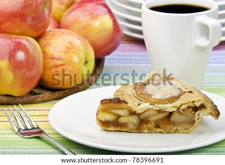 Sweet apple pie with coffee and apples