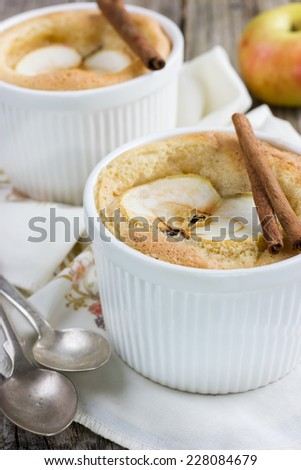 Sweet apple souffle with apple slice and cinnamon, selective focus - stock photo