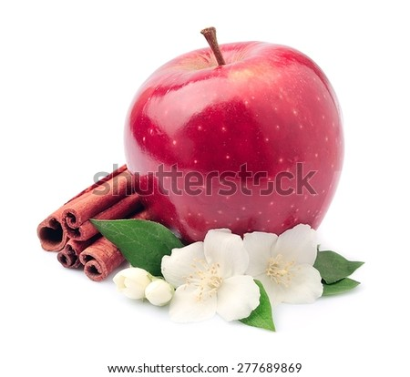 Sweet apple with cinnamon rods and jasmin flowers - stock photo