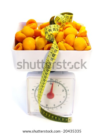 Sweet apricots, scale and tape measure isolated