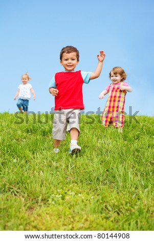 Sweet baby boy running from the hill - stock photo