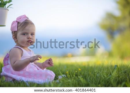 Sweet baby girl playing outdoors. Baptism, Wedding & Fashion - stock photo