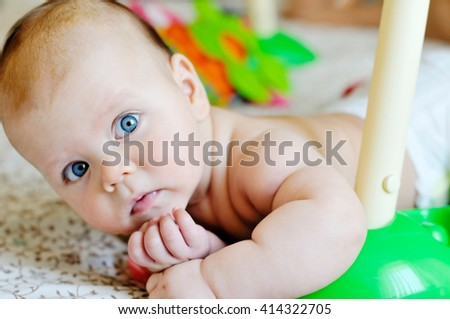 sweet baby girl playing with the toys - stock photo