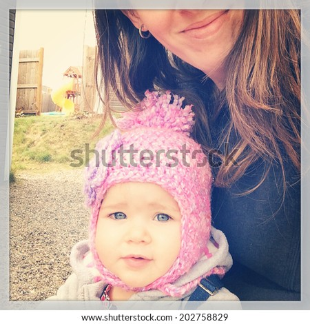 Sweet baby girl with her mother - instagram effect