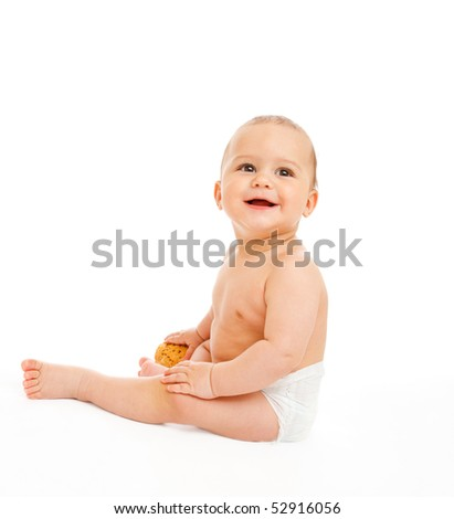 Sweet baby in diaper holding bun in hand - stock photo