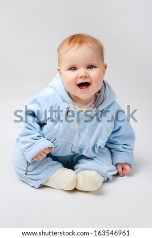 sweet baby on a white background in a blue outfit