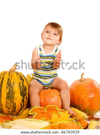 Sweet baby sitting on the pumpkin, over white