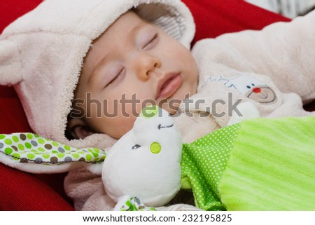 Sweet baby sleeping with stuffed rabbit - stock photo