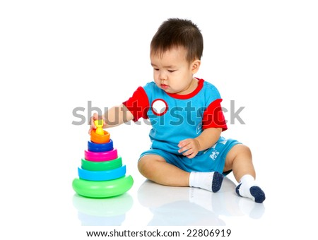 Sweet baby with a toy. Isolated over white background