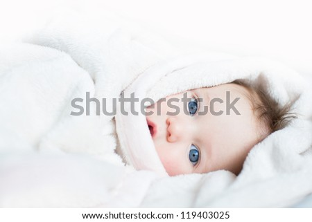 Sweet baby with blue eyes playing peek-a-boo - stock photo