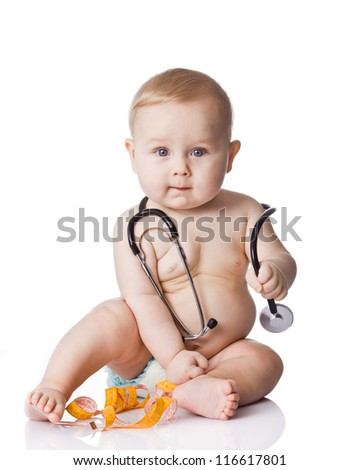 Sweet baby with stethoscope and measure tape on a white background. Adorable baby boy on white