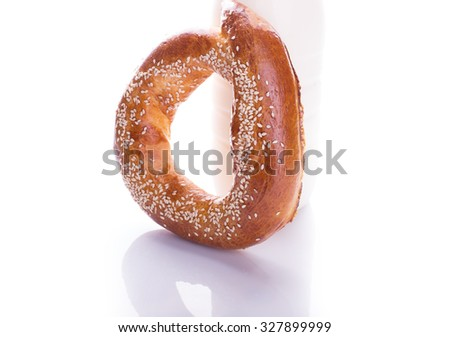 Sweet bagel with sesame isolated on white background - stock photo
