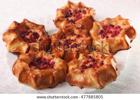sweet baked cakes with berries on plate