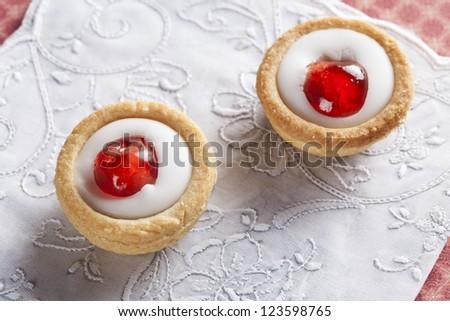 Sweet bakewell pastry treats on white napkin. - stock photo