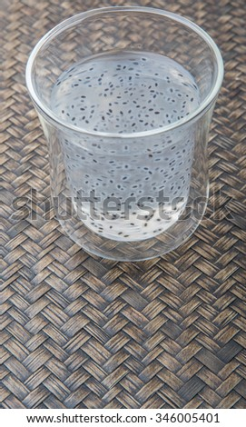 Sweet basil seed drink over wooden background