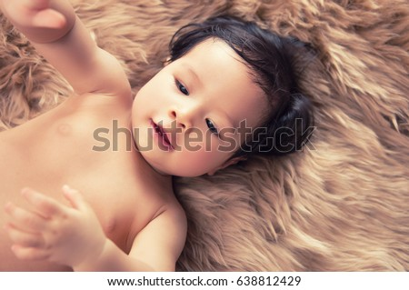Sweet Beautiful baby girl on beautiful brown furry background.Baby concept.