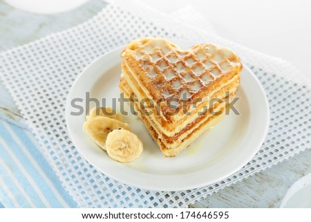 Sweet Belgium waffles with banana, isolated on white