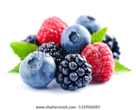 Sweet berries mix isolated on white background. Ripe raspberry and blueberries.