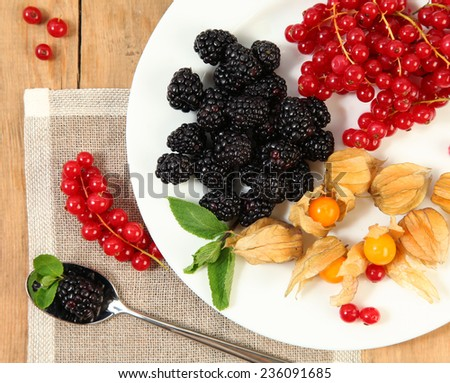 sweet berries on white plate