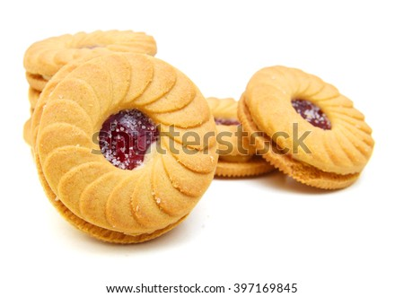 Sweet biscuits filled with raspberry on white