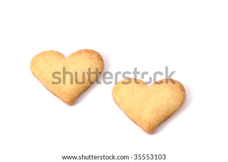 Sweet biscuits in shape of hearts (isolated) - stock photo