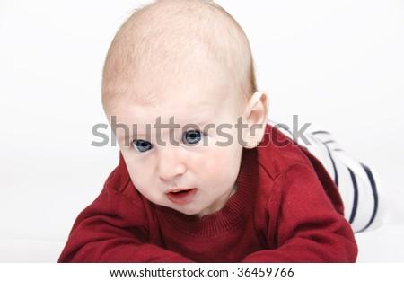 Sweet blue eyed baby against white background - stock photo