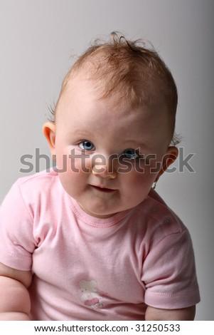 Sweet blue eyed baby girl smiling on fine art portrait - stock photo