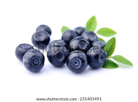 Sweet blueberries with leaves close up .  - stock photo