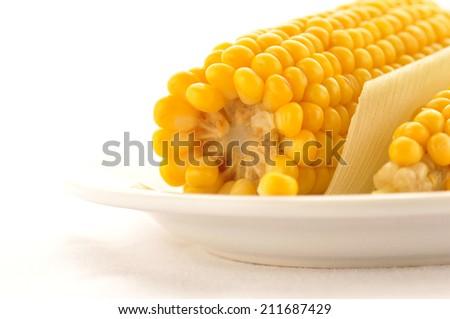 Sweet boiled corn on white background - stock photo