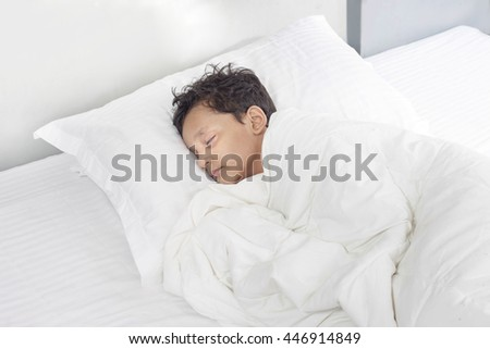 sweet  boy sleeping in bed, happy bedtime in white bedroom.  Sleeping child