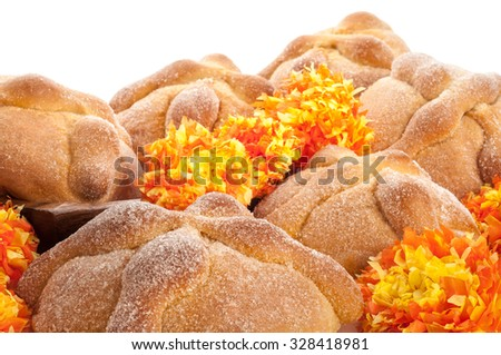 Sweet bread called Bread of the Dead (Pan de Muerto) enjoyed during Day of the Dead festivities in Mexico. - stock photo