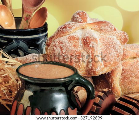 Sweet bread called Pan de Muerto with hot chocolate eaten in the Day of the Dead - stock photo