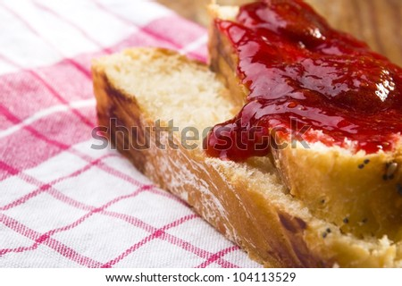 Sweet bread ( challah ) with strawberry jam - stock photo