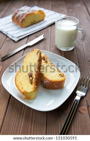 Sweet bread with raisin on wood table
