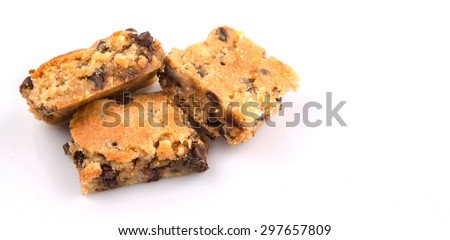 Sweet brownie dessert bar with chocolate chips over white background - stock photo