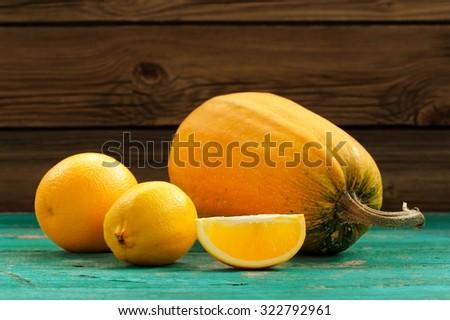 Sweet butternut squash, orange and lemon on wooden turquoise table - stock photo