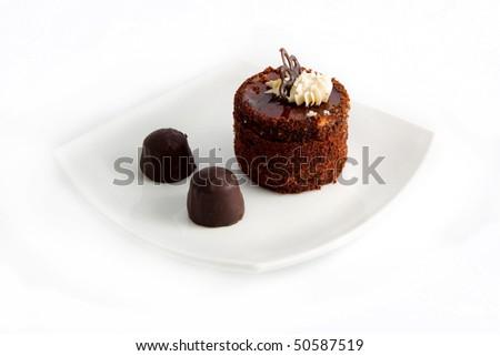 sweet cake on plate isolated on white - stock photo