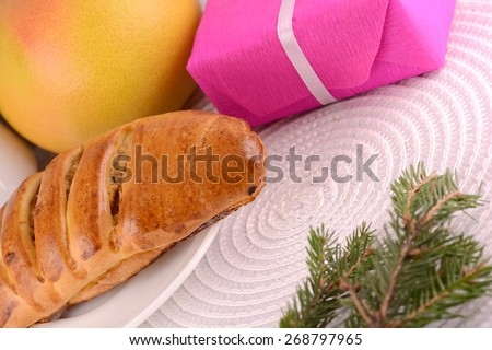sweet cake on white plate, fruits and red gift box - stock photo