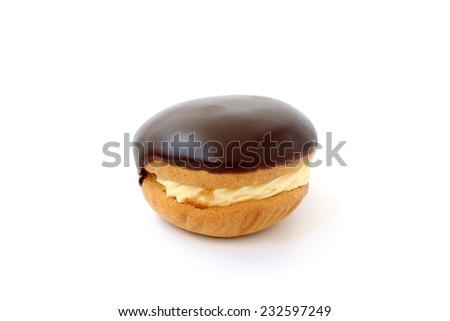 Sweet cake with cream and chocolate fondant - stock photo
