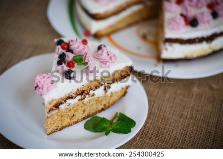 sweet cake with cream and currant on the table - stock photo