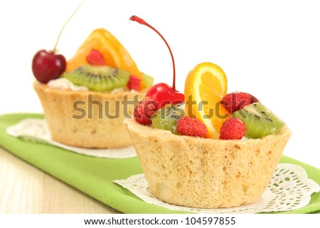 sweet cake with fruits on wooden table - stock photo