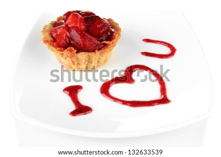 Sweet cake with strawberry and sauce on plate, isolated on white - stock photo