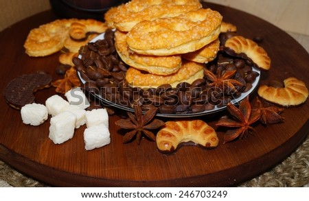 Sweet cakes ,spices and coffee beans - stock photo