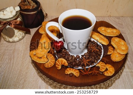 Sweet cakes ,spices and coffee cup and coffee beans - stock photo